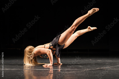 Plexiglas woman fitness competition hand stand pose