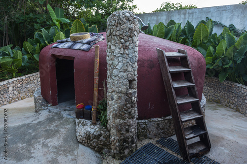 CANCUN, MEXICO - JULE 30, 2013: A visit to the national Mayan Temazcal sauna. © Oleg Anisimov
