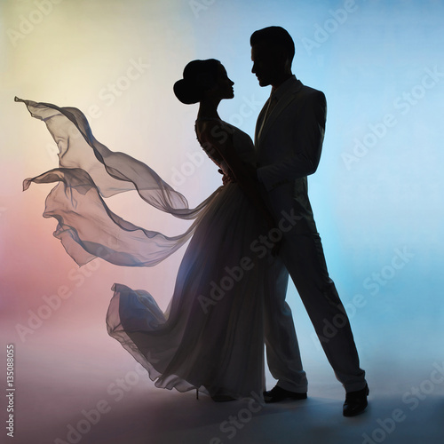 Wedding couple silhouette groom and bride on colors background
