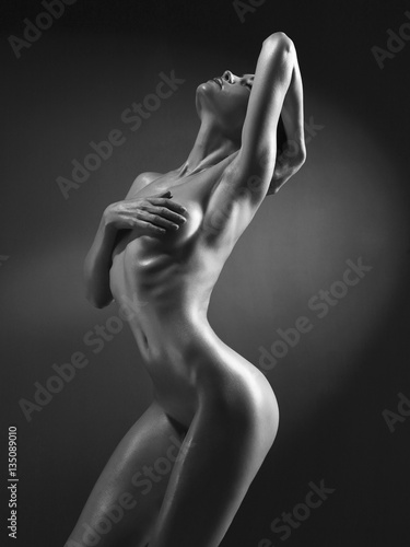 Juliste Elegant nude model in the light colored spotlights