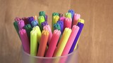 Felt-tip pens are rolled in a support