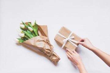 Top view bouquet of white tulips, box gift and accessories