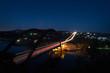 A timelapse view of an Austin Texas landmark, the 360 Pennybacker Bridge, at night.