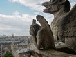 The gargoyles of Notre Dame overlooking the city of Paris France.