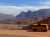 Yellow Kombi parked in front of red dry valley on the way to Cafayate in Nth Argentina.