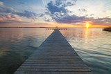 wooden pier overlooking the lake, the beautiful evening sky, colored by the setting sun