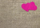A two decorative pink hearts on gray background