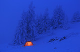 Red tent in the snow of the Vercors mountains in France.