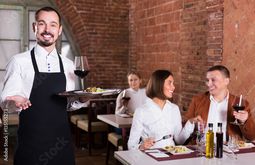 Male waiter in country restaurant