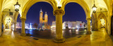 Panoramic view of Sukiennice and St. Mary's Church at night in Krakow, Poland