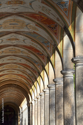 Architectural composition. Ancient colonnade with colored frescoes in perspective. Vysehrad, Prague, Czech Republic. - 135159471