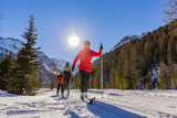 A family group of cross country skiers on a sunny winter morning - 135167265