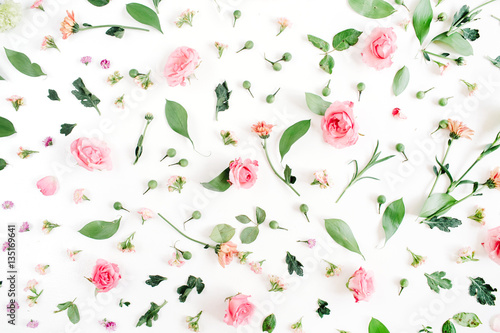Foto Murales Floral pattern made of pink and beige roses, green leaves, branches on white background. Flat lay, top view. Valentine's background