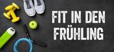 Fitnessausrüstung auf dunklem Hintergrund - Fit in den Frühlin