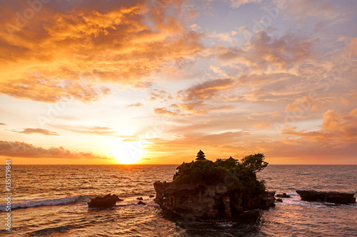 Staande foto Bali Sunset at Tanah Lot temple. Bali island, Indonesia.