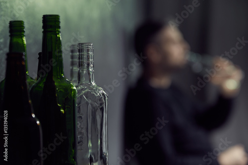 Empty bottles of alcohol Poster