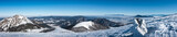 Panorama from top of winter mountains