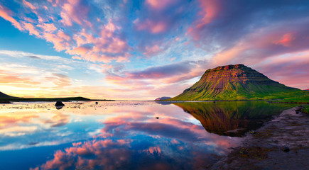 Colorful summer sunset with Kirkjufell Mountain in Grundarfjordu
