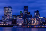 City of London buildings at dusk on the River Thames