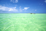Tropical lagoon with turquoise water and boat in Zanzibar