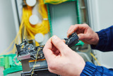 fiber optic cable splice machine in work