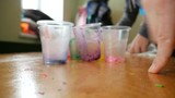 Making colorful wax candle with children