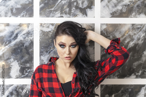 Poster young girl professional makeup punk style plaid shirt red black darkening of exc
