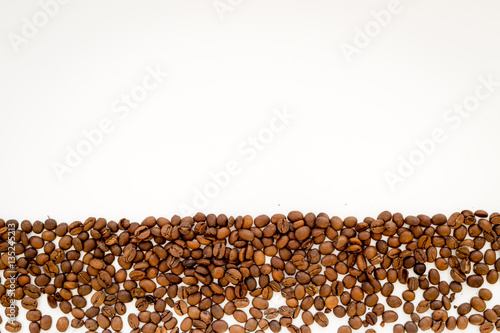 Fotobehang Koffiebonen coffee beans on white table top view mock up