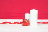 red heart and white candles with red background