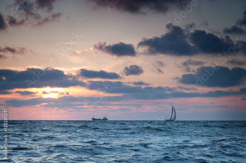 Poster Ships at sea against the sky with clouds at sunset