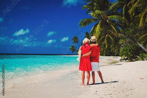 Poster happy loving couple walking on beach