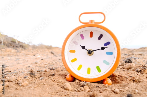 Classic Analog Clock In The Sand Poster