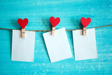 white sheet of paper on the clothespin with hearts - 135285265