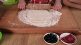 Three kids kneading dough for pizza