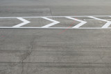 Texture of road with marking on an autodrome for high speed races. Day lighting and cloudy but sunny weather.