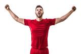 Man wearing red uniform celebrates on white background