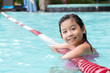 Asian child in the pool