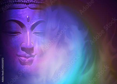 Mystical Buddha Background - ethereal colored gaseous vapors rising up with a partial Buddha head emerging from the darkness on left side and copy space on right