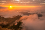 The beautiful sunrise over landscape of the sea mist cover the highland mountains named Phu Chi Dao located in Chiang Rai province in northern region of Thailand.