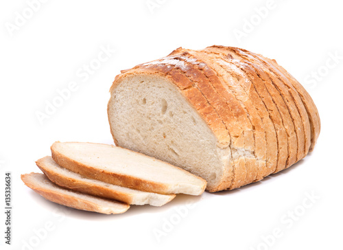 Fototapeta Sliced crusty country style round organic french bread isolated on white background