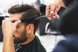 Fototapety Barber using scissors and comb