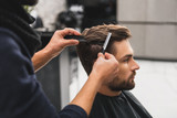 Fototapety Male client getting haircut by hairdresser