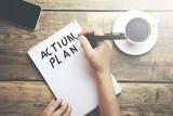 Woman write action plan text