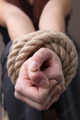 Poster Tied rope hands of girl