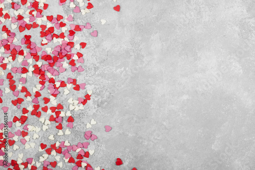 Pink, white and red hearts on a light background. Top view, copy