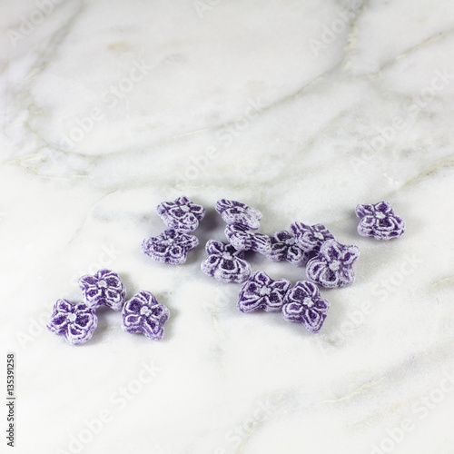 Violet candies, typical Madrid sweets, on white marble