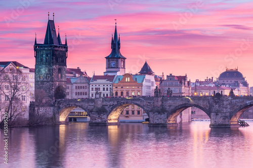 Charles Bridge in Prague with sunset sky in background, Czech Republic