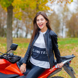 Portrait of a beautiful hipster girl on a sports motorcycle
