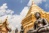 On the way to the sky, spiritual elevation and ascension, golden buddhist pagoda with buddha statues, Doi Suthep, Chiang Mai, Thailand