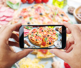 Taking photo of pizza by smartphone. - 135414091